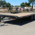Summit 10OA-20-CAS-SPMT-DT-SRAMPS 10K tandem, over axle trailer with slide out ramps, front rub rail and radial tires front rs view