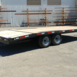 Summit 10OA-20-CAS-SPMT-DT-SRAMPS 10K tandem, over axle trailer with slide out ramps, front rub rail and radial tires rear cs view