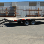 Summit 10OA-20-CAS-SPMT-DT-SRAMPS 10K tandem, over axle trailer with slide out ramps, front rub rail and radial tires rear cs view ramps out