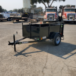 Summit brand 19SV-6-ALP-LTSP utility trailer with solid sides light-speed rear gate and radial tires in a 4'x6' configuration front rs view