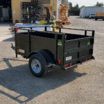 Summit brand 19SV-6-ALP-LTSP utility trailer with solid sides light-speed rear gate and radial tires in a 4'x6' configuration rear rs view by Johnson Mfg. Woodland, CA
